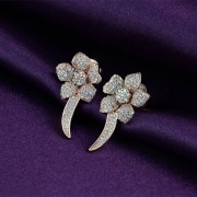 Silver earrings flowers with zircons in rhodium