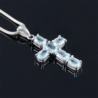 Classic silver cross with blue topaz