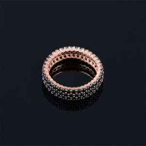 Silver ring with rose gold and onyx