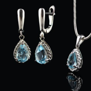 Silver set with Topaz blue gemstones